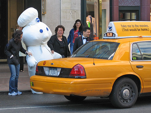 Pillsbury Dough Boy being escorted into a taxi